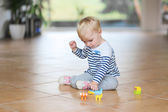 Baby girl play with plastic bricks — Stock Photo