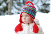 Girl playing outdoors in the snow — Stock Photo
