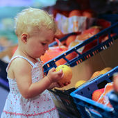 Baby girl picked  vegetables and fruits — Stock Photo