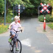 Boy cycling after school on bike — Stock Photo