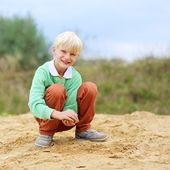 Boy playing with sand — Stock Photo