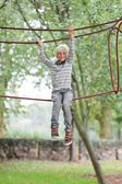 Boy climbs on the ropes — Stock Photo