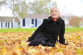 Senior woman enjoying autumn — Stock Photo