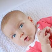 Baby girl in pretty red dress — Stock Photo