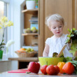 Girl preparing healthy salad — Stock Photo