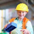 Boy building a house with big plastic construction bricks — Stock Photo #42871023