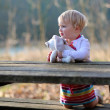 Girl sitting at picnic table in the forest — Stock Photo