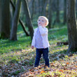 Toddler girl playing in spring forest — Stock Photo