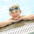 Boy swimming in outdoor pool — Stock Photo #43658691