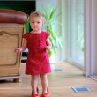 Toddler girl trying mom's shoes — Stock Photo