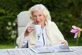 Senior woman drinking coffee — Stock Photo