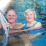 Senior couple in the swimming pool — Stock Photo #45036005