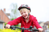 School boy riding his bike — Stock Photo