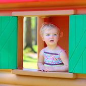 Cute toddler girl playing in playhouse — Stock Photo