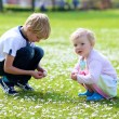 Boy with his sister on a sunny spring day — Stock Photo