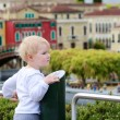 Little girl looks at miniature installations at amusement park — Stock Photo #46094913
