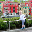 Little girl looks at miniature installations at amusement park — Stock Photo #46094937