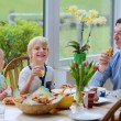 Family having healthy breakfast — Stock Photo