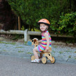 Happy little child in safety helmet riding wooden tricycle — Stock Photo #46835269