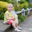 Cute little girl playing with teddy bear on the street — Stock Photo #46994367