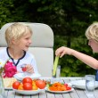 Two young boys having healthy lunch outdoors — Stock Photo #47337149