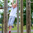 Happy teenager boy having fun on playground in the park — Stock Photo #48734037