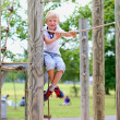 Happy teenager boy having fun on playground in the park — Stock Photo #48734041