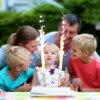 Happy family of five celebrating birthday of 2 years old child with cake and candles — Stock Photo #49487307