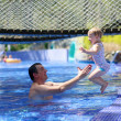 Happy father and little daughter having fun in outdoors swimming pool — Stock Photo