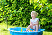 Happy little girl playing with sandbox outdoors  on a sunny summer day — Стоковое фото