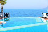 Infinity swimming pool with beautiful view on Aegean Sea at the luxury hotel, Turkey — Stok fotoğraf
