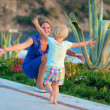 Mother and little daughter enjoying summertime outdoors — Stock Photo #49816983