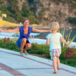 Mother and little daughter enjoying summertime outdoors — Stock Photo #49816985
