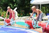 Two happy boys having fun in aqua park — Stock Photo