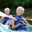 Two happy school boys kayaking on the river — Stock Photo #49922269