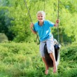 Happy boy swinging in the park — Stock Photo #50240433