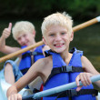 Two happy school boys kayaking on the river — Stock Photo #50845547