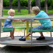 Brother and sister playing in summer park — Stock Photo #50845603