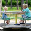 Brother and sister playing in summer park — Stock Photo #50845607