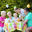 Happy family of five having lunch outdoors — Stock Photo #50845701