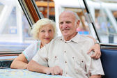 Happy senior couple during boat sightseeing tour in Amsterdam — Stock Photo