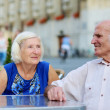 Senior couple relaxing in outdoors cafe — Stock Photo #51793279