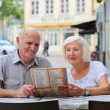 Lovely senior couple relaxing in outdoors street cafe — Stock Photo #51793309