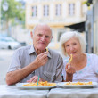 Lovely senior couple relaxing in outdoors street cafe — Stock Photo #51793311