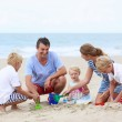 Happy family of five having fun on the beach — Stok fotoğraf