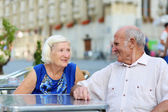 Senior couple relaxing in outdoors cafe — Stock Photo