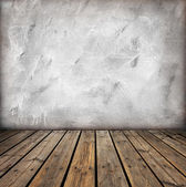 Wooden floor and gray wall — Stock Photo