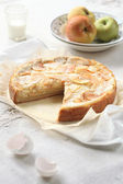 Apple Pie on baking paper, with fresh apples — Stock Photo