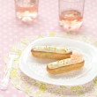 Pistachio Eclairs on a white plate — Stock Photo