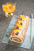 Striped Roll Cake with chocolate filling and tangerines — Stock Photo